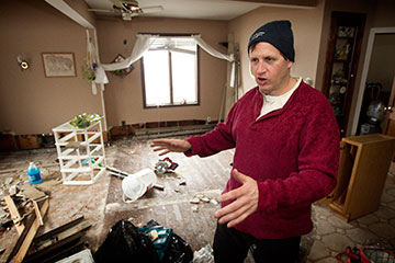 Peter Vasquenz describes damage to his mother's home in the Staten Island borough of New York following Hurricane Sandy in November 2012.