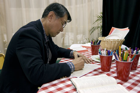 The Rev. Bo Joong Kim finds a quiet space to write in the Prayer Room at the 2008 United Methodist General Conference in Fort Worth, Texas.