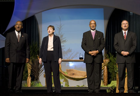 "United Methodist agency leaders sing ""Lift High the Cross"" after speaking on the Areas of Focus. From left are the Rev. Jerome King Del Pino, the Rev. Karen Greenwaldt, Bishop Felton May and the Rev. Larry Hollon."