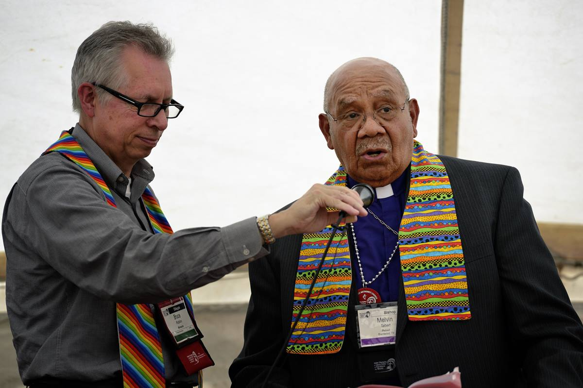 Retired Bishop Melvin G. Talbert (right) joined 14 other United Methodist bishops at a gathering on May 4 outside the 2012 United Methodist General Conference in Tampa, Fla., organized by groups that want to see the church change its stance on homosexuality. Holding the microphone is the Rev. Bruce Robbins, retired former pastor of Hennepin Avenue United Methodist Church in Minneapolis, A UMNS photo by Paul Jeffrey.
