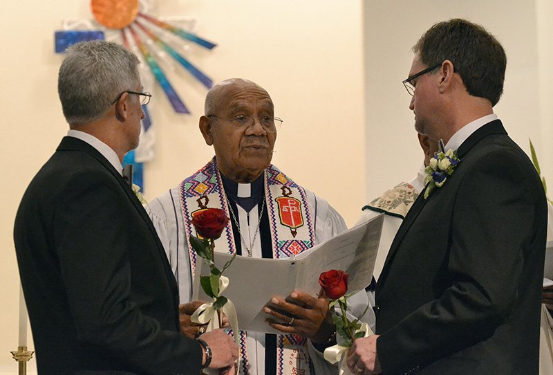 United Methodist Bishop Melvin Talbert (center) marries Joe Openshaw (left) and Bobby Prince at Covenant Community United Church of Christ in Center Point, Ala. Photo by the Rev. Laura Rossbert, Reconciling Ministries Network.