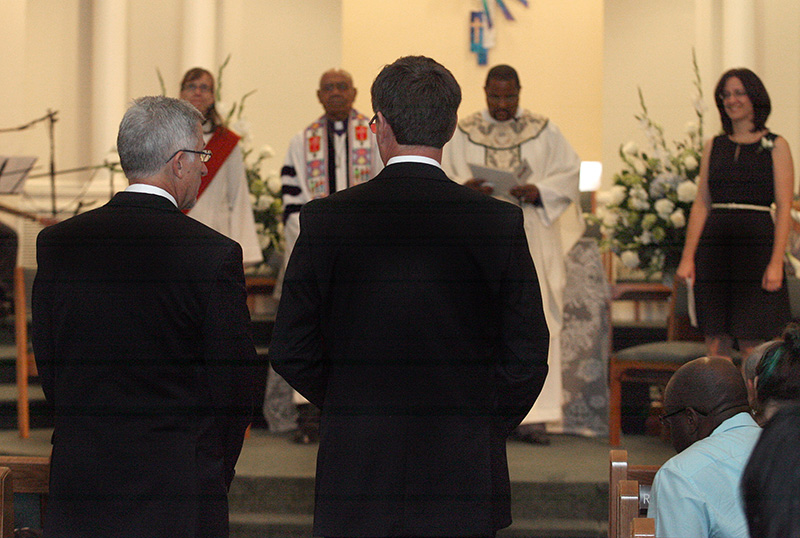 Joe Openshaw (left) and Bobby Prince approach the altar to be married by United Methodist Bishop Melvin Talbert (second from left in background) at Covenant Community United Church of Christ in Center Point, Ala. A UMNS photo by Kathy L. Gilbert.