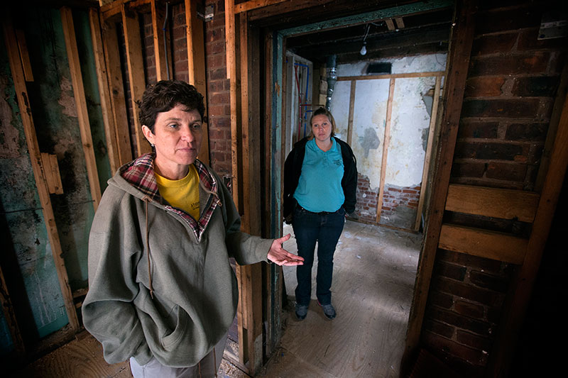 Bobbie Ridgely (left) and Katie Quigley discuss the progress of repairs at a home damaged by Hurricane Sandy in Atlantic City, N.J. They work for A Future With Hope, a long-term recovery program of the Greater New Jersey Conference of The United Methodist Church.