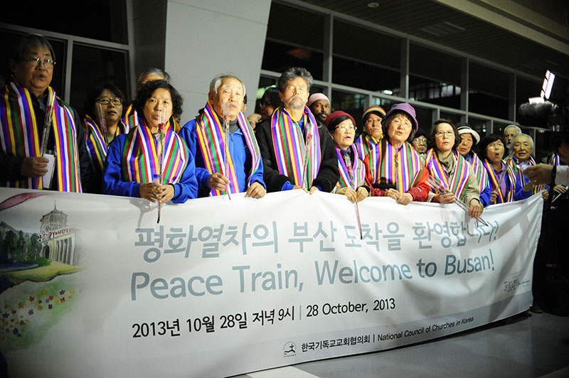 Peace train arriving to Busan. The travelers gathered in prayer for peace. Joanna Linden-Montes/WCC
