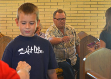Children collect funds for school supplies and uniforms for local residents affected by Hurricane Isaac at Huff Chapel United Methodist Church in Killian, La.