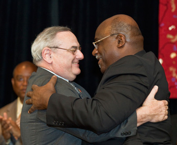 Bishops Goodpaster and Palmer embrace following the passing of the gavel.  A UMNS photo by James D. DeCamp.