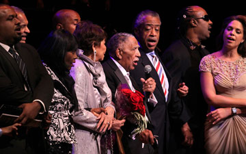 The Rev. Joseph E. Lowery (with microphone) leads the singing of We Shall Overcome during his 90th birthday celebration Oct. 9, 2011 at the Atlanta Symphony Hall. A UMNS photo by Kathleen Barry.