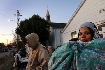 In the early hours of dawn, Tagawunia Tarleton waits outside Sixty-First Avenue United Methodist Church in Nashville to receive a ticket to shop for her nine children at the Last-Minute Toy Store. A UMNS photo by Kathleen Barry.