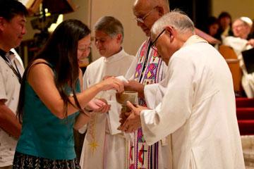 Western Jurisdiction bishops serve communion during July 18 worship. Photo by Patrick Scriven.