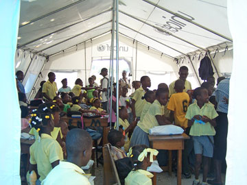 Four classes from Mellier school meet in a donated UNICEF tent at the Mellier Methodist Church compound.