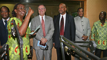 Acquah expresses her joy before guests (from left) Yao Saki, the Rev. Larry Hollon, the Rev. Gary Henderson and Pascal N'Guessan Affi.