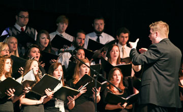 Nathan Windt directs the Concert Choir at Tennessee Wesleyan College in Athens, Tenn. A UMNS photo courtesy of Tennessee Wesleyan College.