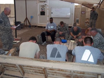 Chaplain John Branning leads a service of Holy Communion following a mortar attack in Taji, Iraq. A UMNS photo courtesy of Chaplain John Branning.