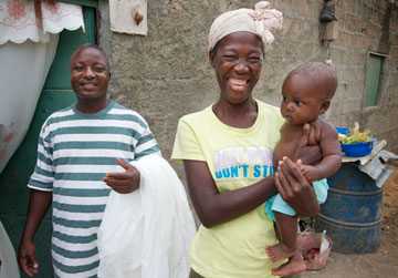This Angolan family received a net as part of The United Methodist Church's Imagine No Malaria campaign. (From left) Domingos Adao, Esperances Manuel and baby Sandro dos Santos. A UMNS photo by Mike DuBose.