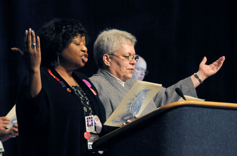 Garlinda Burton (left) and Kim Coffing lead a worship service at the 2008 United Methodist General Conference in Fort Worth, Texas. A UMNS photo by John C. Goodwin.