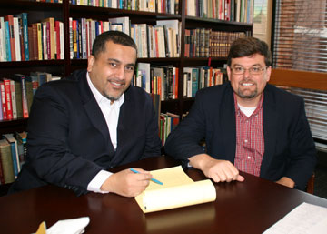 Peter Messiah, director of addiction prevention studies, and Mark Davies, dean of the Oklahoma City University Petree College of Arts and Sciences, review plans for the United Methodist school's undergraduate degree in addiction prevention studies.