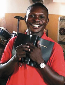 This smile shows the happiness felt by a man in the Democratic Republic of the Congo who is holding a Bible in his own language.