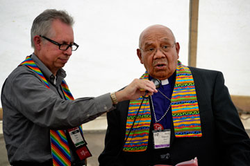 Retired Bishop Melvin G. Talbert (right) joined 14 other United Methodist bishops at a gathering on May 4 outside the 2012 United Methodist General Conference in Tampa, Fla. The gathering was organized by groups that want to see the church change its stance on homosexuality. A UMNS photo by Paul Jeffrey.