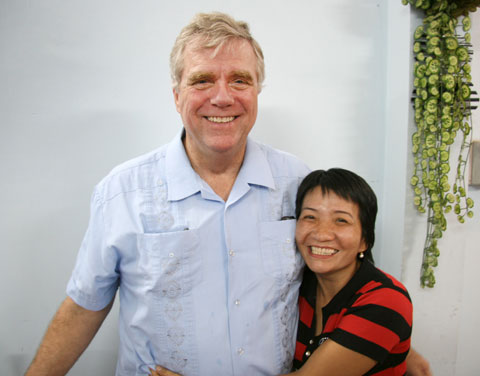 The Rev. Clinton Rabb shares a hug with a church member during worship in Ho Chi Minh City, Vietnam, in September 2008. A UMNS photo by Adam Neal, GBGM.