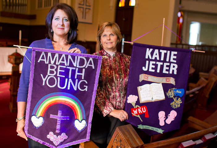 Beth Young (left) and Mamie Jeter hold banners honoring their daughters, Amanda and Katie. UMNS photos by Mike DuBose.