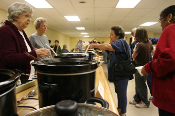Rome, Ga.'s Chapel Hill United Methodist Church members Billie Dixon (left) and Barbara Dixon offer homemade soup to Susan Cox, whose home was lost in the Feb. 29 tornado. A web-only photo by Lauren Jones/Rome News-Tribune.