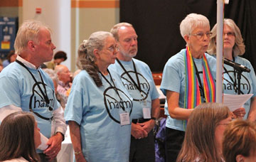 Members of the Iowa Annual (regional) Conference  wear shirts