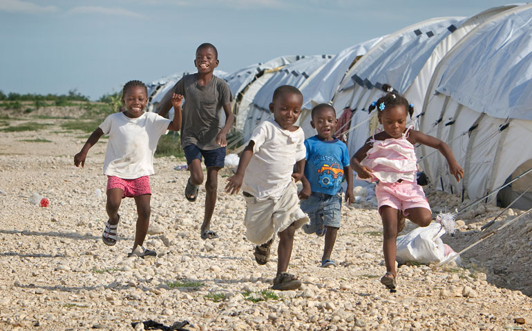 Children play between rows of tents at Camp Corail where the United Methodist Committee on Relief is helping provide services.