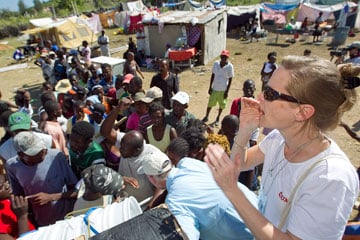 Melissa Crutchfield helps distribute water treatment supplies to people living in a makeshift camp in Gresier, Haiti, after the January 2010 earthquake.