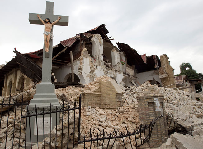 A crucifix stands amid the rubble of Sacred Heart Catholic Church in Port-au-Prince, Haiti.