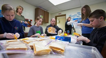 Youth from Medford and Epworth United Methodist churches in Elizabeth, N.J., pack lunches for area needy. A UMNS photo by Gwen Kisker.