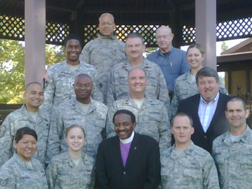 United Methodist Bishop Woodie White (front row, center) and the Rev. Randy Cross (second row, right) visit with the chaplaincy team stationed at Osan Air Force Base in South Korea. A UMNS web-only photo courtesy of the United Methodist Endorsing Agency.