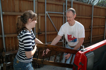 Tom Hutson and his daughter, Amy, load a donated headboard for delivery through the Custer Road United Methodist Church's Head Start Bed Start ministry.  Head Start serves 3-year-olds and 4-year olds whose families are living in poverty.  A UMNS photo by John Gordon.