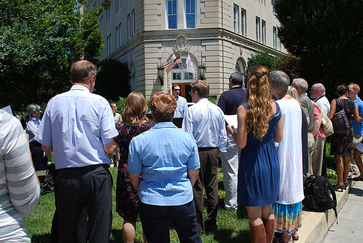 "Jim Winkler leads a prayer vigil for a ""faithful budget"" in front of The United Methodist Building in Washington. Photo by Wayne Rhodes, GBCS."