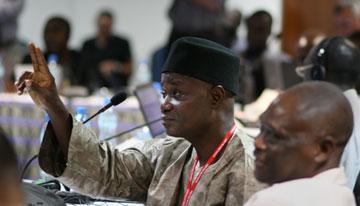 Elisha Mazadu Bakila, Nigeria, asks for clarification during the Pan African health board summit.