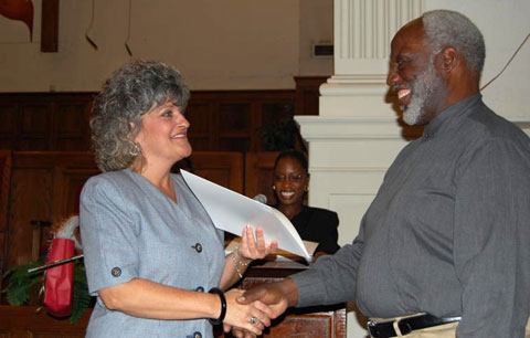 Ruth Jones (center) announces Laura Duarte valedictorian of 2009's Class 16 as the Rev. William H. Robinson, executive director of Better Community Development Inc., presents her with a certificate of completion. Web-only photos courtesy of Better Community Development Inc., Little Rock, Ark.