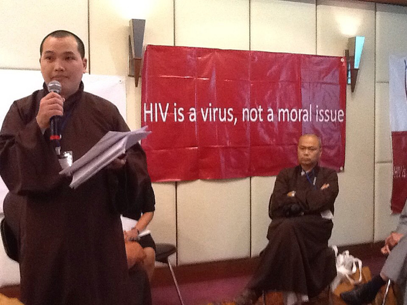 Buddhist monks share the message during Bangkok gatherings on AIDS in Asia and the Pacific. UMNS Photo by Donald Messer.