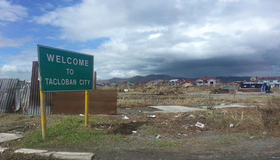 A sign that withstood the 195-mile-an-hour winds of Typhoon Yolanda stands outside Tacloban City in the Philippines.  Photo courtesy of April Grace Mercado.
