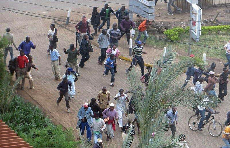 Crowds flee during the sound of gunfire near Westgate mall in Kenya. Photo by Anne Knight/Creative Commons.