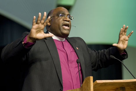 Bishop Gregory Palmer delivers the parting message to General Conference delegates during closing worship.