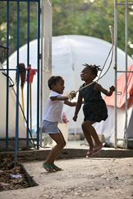 Schoolchildren from the College de Freres enjoy skipping rope.