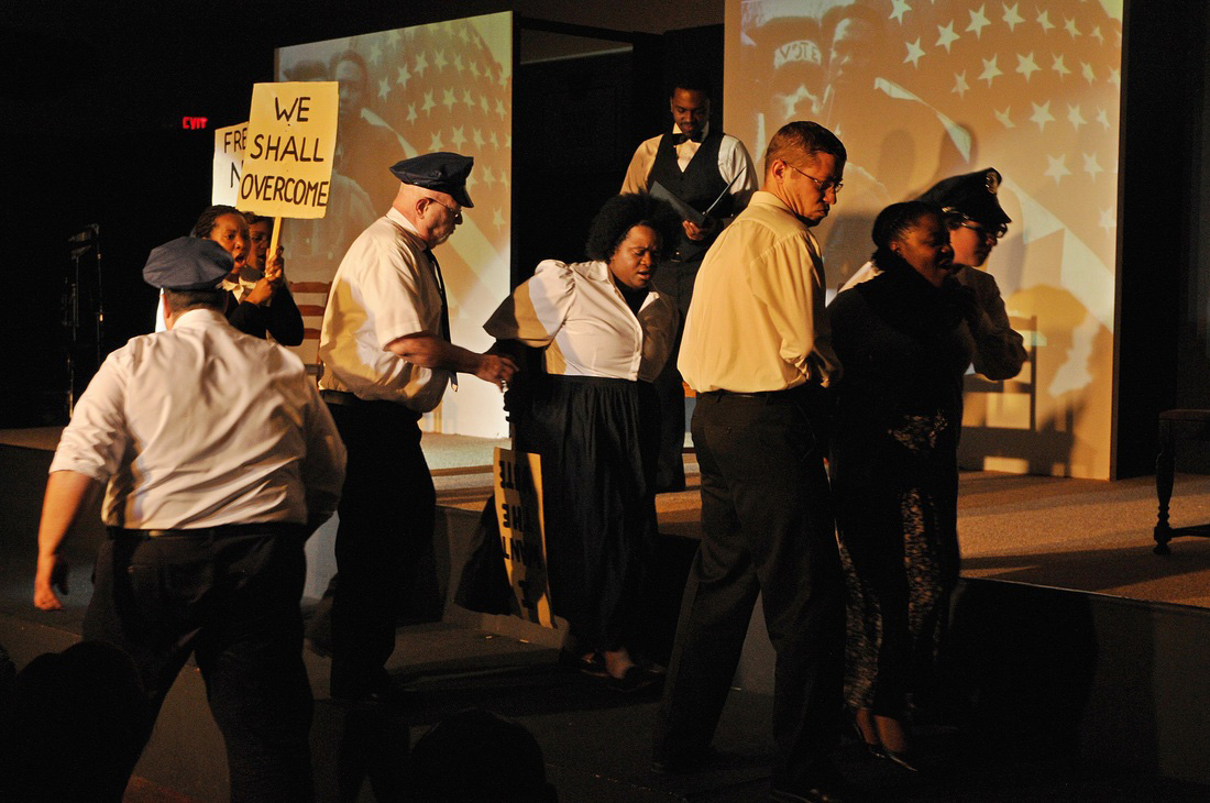 """In this scene from """"I Have a Dream"""" The Musical from TheatreSouth Atlanta, city official Bull Conner enforces segregation policies by arresting marchers during a 1963 civil rights demonstration in Birmingham, Ala. UMNS Photo by Yonnick Jones."""