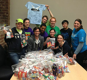 Students from Southwestern College in Winfield, Kan., package food kits for street kids in Atlanta through a ministry called Stand Up for Kids. At right is campus minister the Rev. Ashlee Alley. Photo courtesy of Southwestern College.