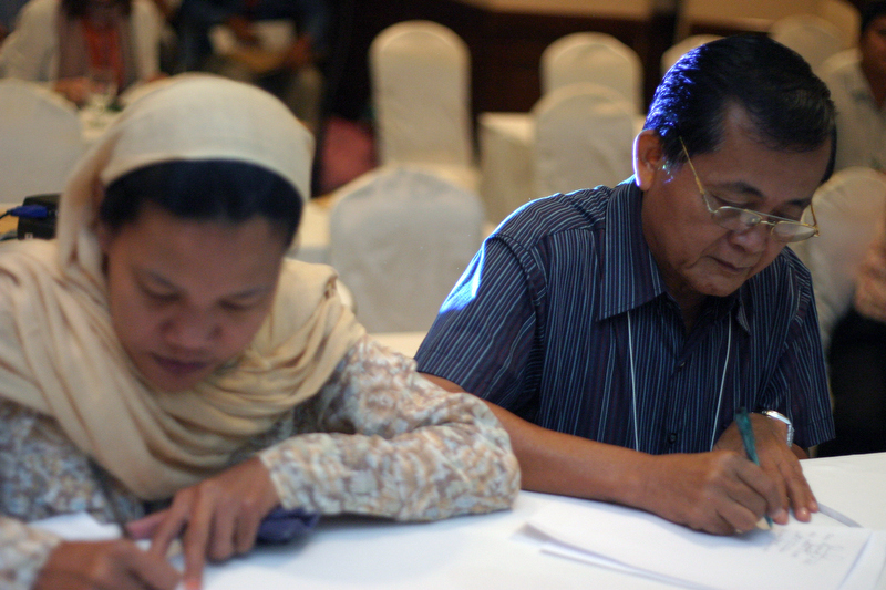Hadja Fauziah Musa and the Rev. Julius Camanong participate in a Muslim-Christian Peace Building Dialogue in Davao City, Philippines, in 2007.