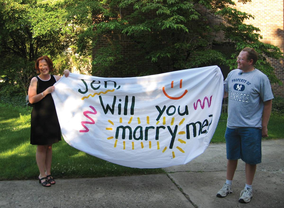 """Jennifer Dobbs and Matthew Oates share a moment after she said, """"Yes"""" to his proposal of marriage in July 2008.  Photo by Marsha Esau."""