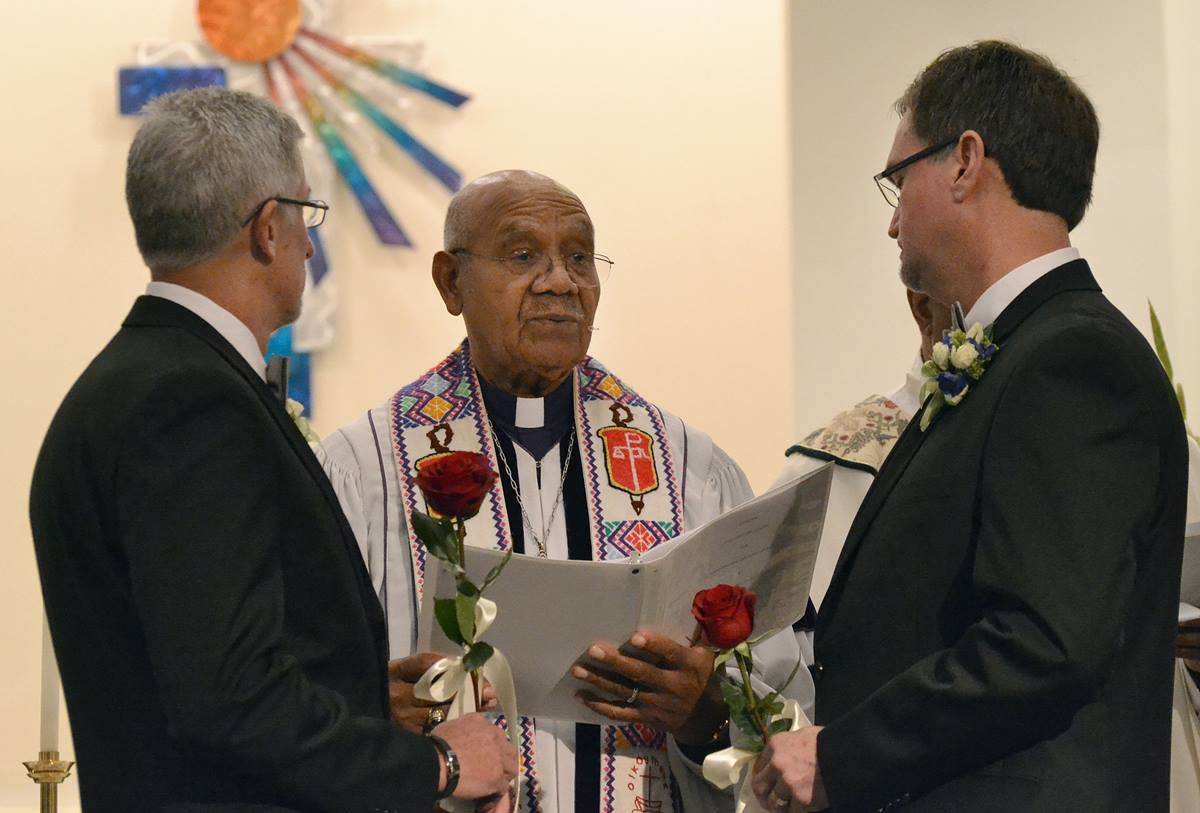 United Methodist Bishop Melvin Talbert (center) blesses the union of  Joe Openshaw (left) and Bobby Prince at Covenant Community United Church of Christ in Center Point, Ala. Photo by Laura Rossbert, Reconciling Ministries Network