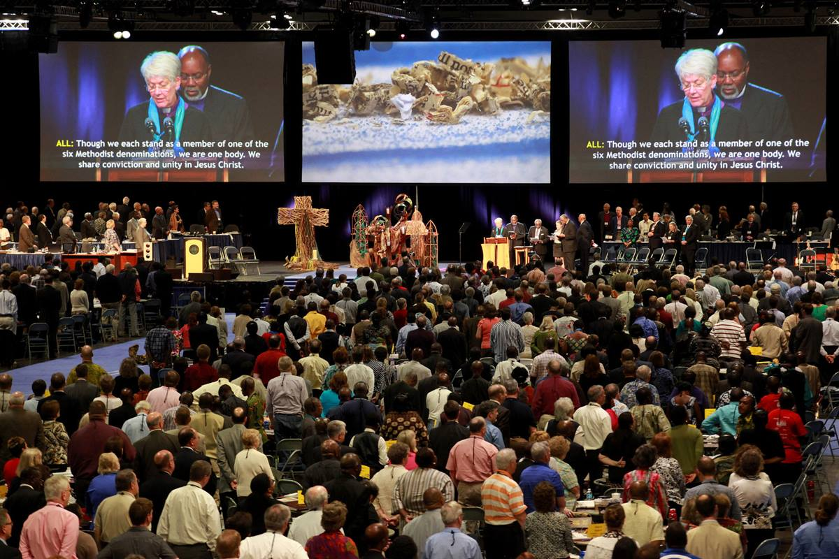 Delegates and visitors fill the plenary hall in the May 1 afternoon celebration of Pan-Methodist Full Communion at the 2012 United Methodist General Conference in Tampa, Fla.  On the screen are Bishop Sharon Rader and Bishop John White.