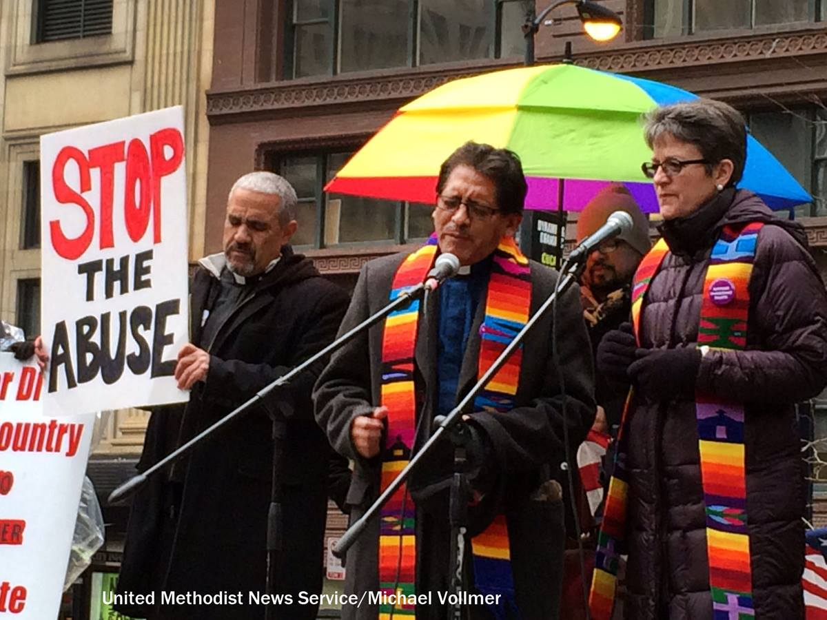 United Methodist clergy (from left) Jesus Molenia, Orlando Moller and Bishop Sally Dyck join other faith leaders in a rally and protest calling upon President Obama to stop deportations of undocumented people. Photo by Michael Vollmer, UMNS.
