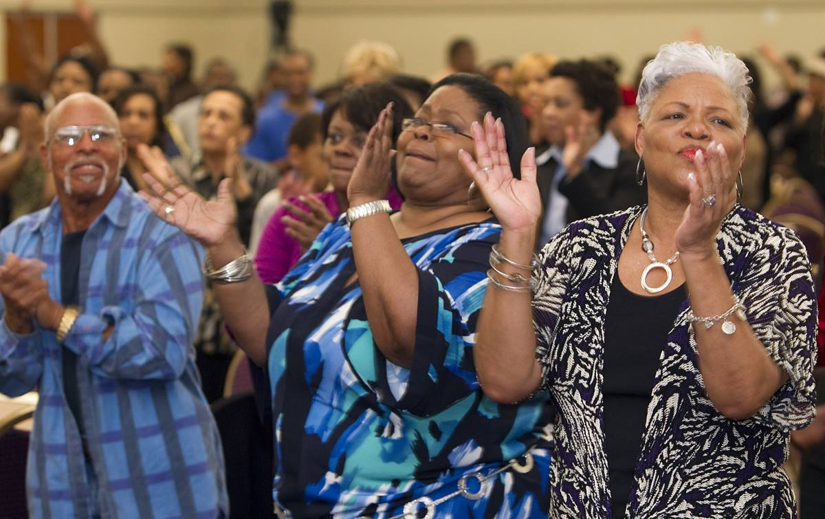 Worshipers sing during a Wednesday evening gathering at Kindgom Builders Center, Windsor Village United Methodist Church in Houston in this 2011 file photo. Photo by Mike DuBose, UMNS.