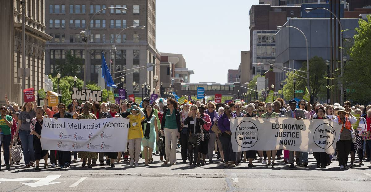 United Methodist Women and community activists rally for economic justice in Baxter Square Park.