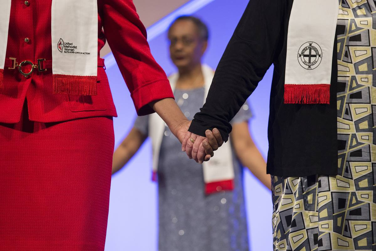 The final worship service on Sunday included consecrating 26 women from 18 conferences as United Methodist deaconesses.